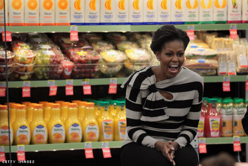 First Lady Michelle Obama promotes healthy food options at a Walgreen's store in Chicago