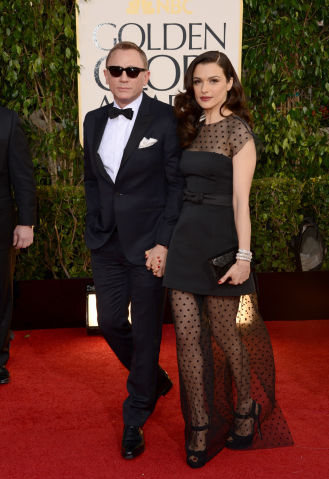 Daniel Craig with Rachel Weisz in Louis Vuitton
