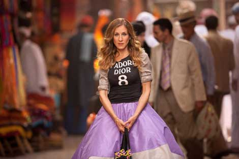 Sarah Jessica Parker as Carrie in Sex and the City 2 wearing the underskirt of a Zac Posen ballgown with a Dior T-shirt worn over a lame blouse in a souk