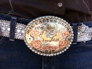 Jolene wears her brother-in-law's trophy buckle
