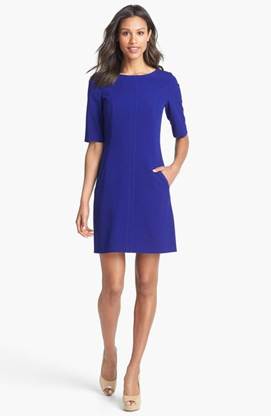 Look for dresses without a set waistband, like this A-Line sheath from Tahari at Nordstrom