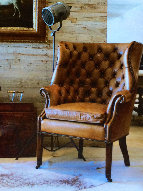 Here is the same wingback chair, I bought as a pair this one done in weathered leather and tufted, One chair and two different ways of approaching the look!.