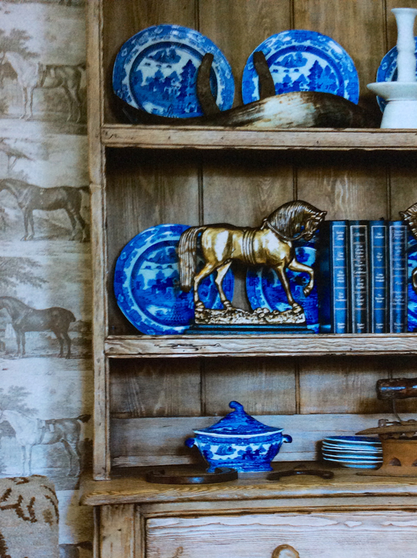 The Horse wallpaper in Smoke I found online with an adhesive back for easy removal, The blue spode dinnerware and turin I carried back from London. The pine Buffet Cabinet came out of a farmhouse in Connecticut