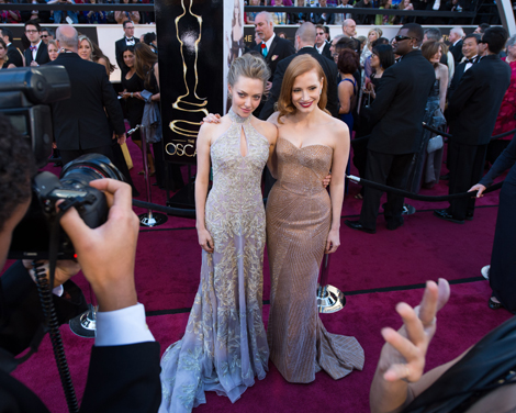 Amanda Seyfried (L) poses with Jessica Chastain (R), Oscar®-nominee for Actress in a Leading Role, as they arrive for The Oscars