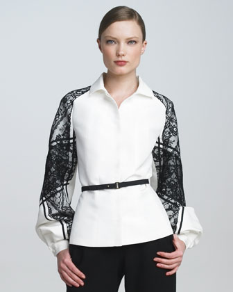 Think of lace as the new glitter, like this elegant take of a crisp white shirt by way of this Carolina Herrera Belted Lace-Sleeve Blouse