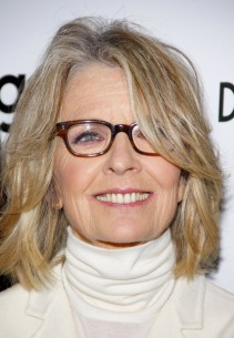 Diane Keaton has dusty blone highlights and soft face framing layers in her hair.