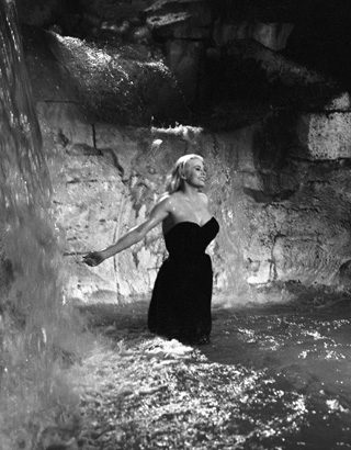"Anita Ekberg frolicing in the Trevi Fountain in ""Le Dolce Vita"""