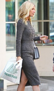 Gwyneth Paltrow wearing AW12 Burberry Prorsum Pre-Collection look 10 and  carrying a  Victoria Beckham Fall 2012 Two Tone Shoulder Bag in Moonstone / Black with her