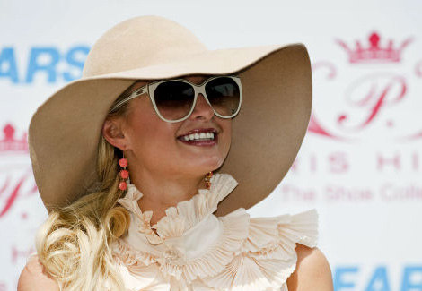 Although all beige, Paris Hilton has far too many things going on that compete with her floppy hat.