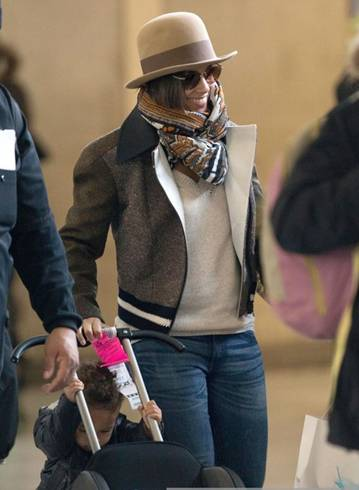Alicia Keys arrives on a flight at the Roissy Charles de Gaulle airport with her son Egypt in Paris, France.