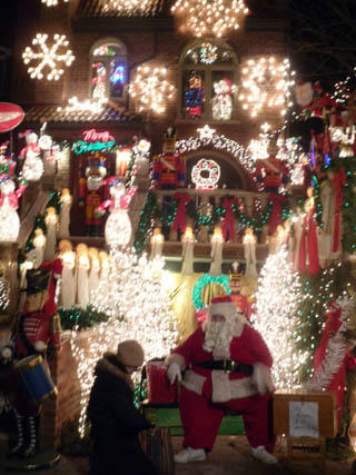 Real Santa outside house in Dyker Heights, Brooklyn