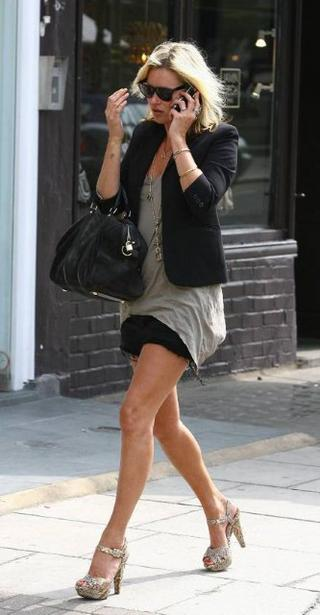 Kate Moss rocks her black Ksubi cut-off shorts in London