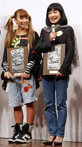 Miyuki Hatoyama, right, wife of Japanese Prime Minister Yuko Hatoyama after being awarded the Japan Jeans Association prize.
