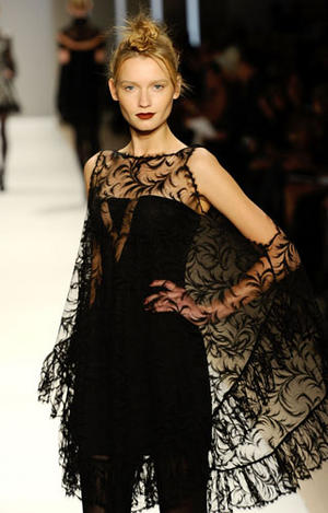 Editions by Georges Chakra black crepe dress with Chantilly lace overlay from the Fall 2010 collection as shown at Mercedes Benz Fashion Week New York
