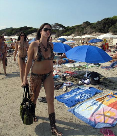 Dressed and undressed on the beach, but always accessorized!