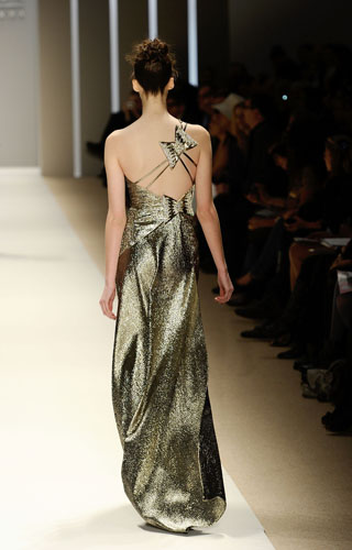 One shoulder gold lame gown with beaded butterfly back details