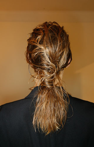 The Wet Look: A sculptural and edgy ponytail.