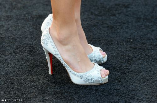 Nikki Reed has her red soles going on