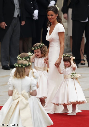 Sister of the bride and Maid of Honour Pippa Middleton (C) holds hands with Grace Van Cutsem (L) and Eliza Lopes