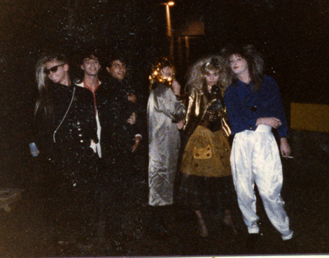 Blast from Halloween Past: Sharon and I hit the streets for a Halloween party a million years ago! We're on the far right. My white silk Hammer pants and her bronze Betsey Johnson dress look modern, still.