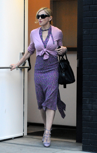 Madonna wearing a vintage Roberto Cavalli dress from the Spring/Summer 2008 Collection out and about in NY yesterday.